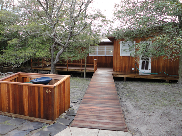 Fire Island Landscaping transformed an unusable backyard into an outdoor living space.